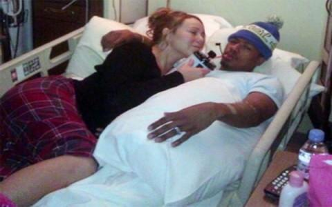 Nick Cannon's back home with Mariah and twins