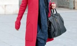 Salma Hayek covers her famous curves in red coat