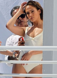 Jennifer Lopez pours her curves into a saucy swimsuit