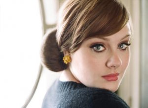 Adele sues French magazine over 'sex tape'
