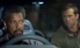 POW! Actor Ryan Reynolds Gives Denzel Washington a Black Eye