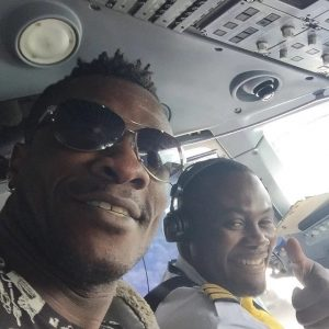 Photo: Asamoah Gyan takes over his flight  to fly