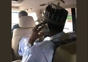 Nigerians react to photo of President Buhari using this type of phone