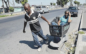 Photo: Man Moves His Wife Around In Trolley Because She Is Special