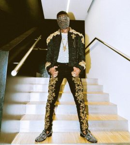 PHOTOS: Starboy WIZKID Causes Confusion as he modeled for Popular Fashion line Dolce and Gabbana in Milan