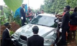 Photo: Nigerian billionaire buries his father in a brand new BMW X6 and social media can't think far