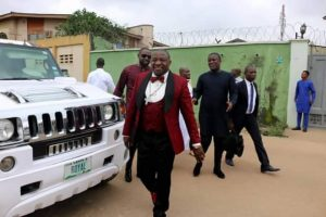 EXPENSIVE ANOINTING!! Bishop Caused Huge Commotion As He Arrives Egbeda In His N80 Million HUMMER LIMOUSINE [PHOTOS]