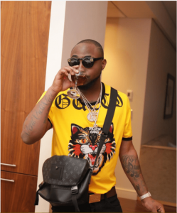 Caught On Camera! We Caught Fan Doing This To Davido During His Performance On Stage [Video]