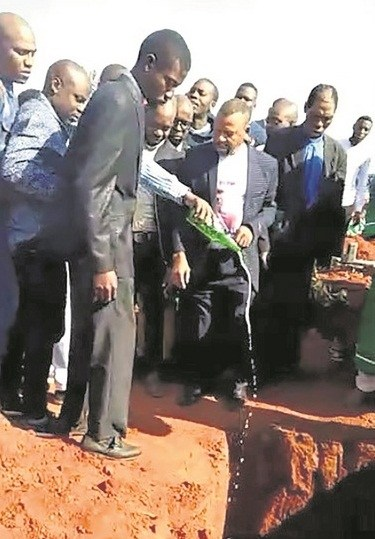 Young S.A Millionaire Buried With Cash, Beer And Phones (Photos)