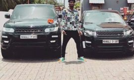 AMG Business signee, Mawuli Younggod poses in between his two luxurious customized Range Rovers