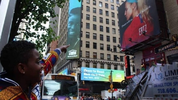 DJ Switch's face appears on a billboard in New York