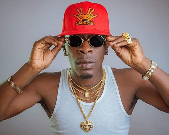 Shatta Wale damages his $65,000 Dodge Charger windscreen for music video.
